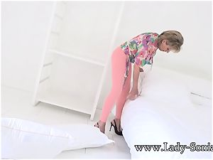 british mature doll Sonia toying with her enormous bumpers