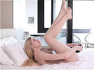 naughty blond fumbles her nub and cooch with a gigantic black faux-cock
