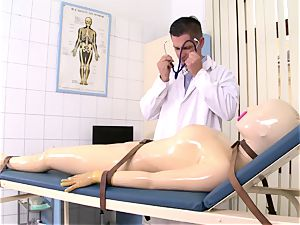 Rubber gal takes doctor's dick in her deep throat and drink