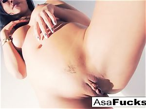 Asa Akira uses a faux arm to sate her slit