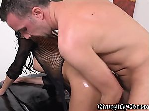 masseur in fishnets covered in jism after rubdown