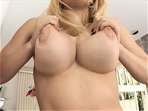 blonde babe Kagney Karter plays with her giant udders