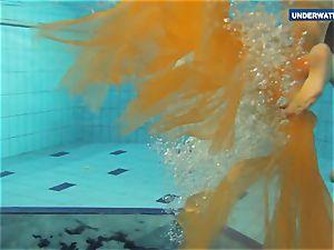 Yellow and crimson clad teenage underwater