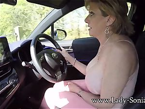 Mature dame Sonia plays with her funbags while driving